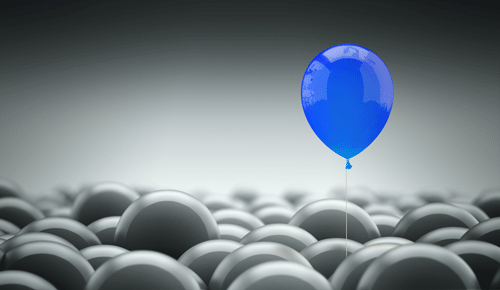 Blue Balloon rising about a sea of white ballons